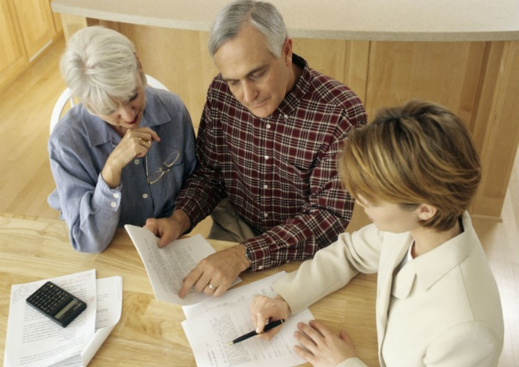 Couple looking over paperwork with advisor