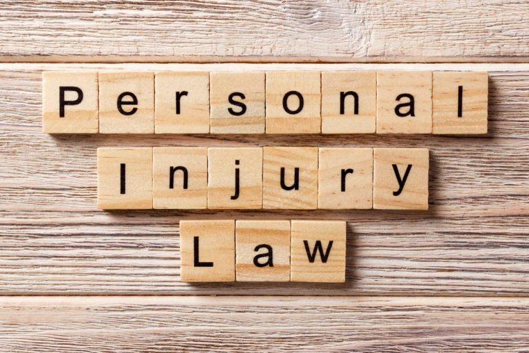 personal injury law word written on wood block. personal injury law text on table, concept.